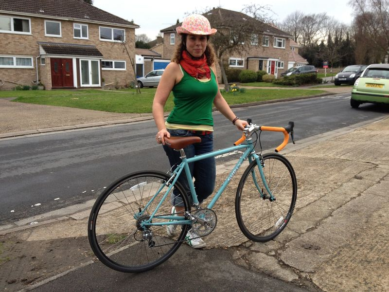Debbie holding her new blue Surly Cross Check