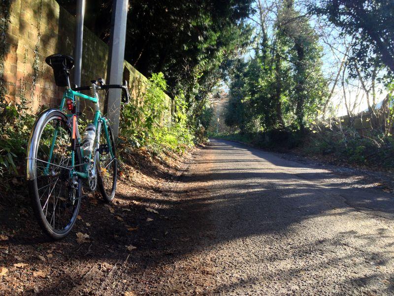 winter cycling on Bob Jackson World Tour bike down a country lane